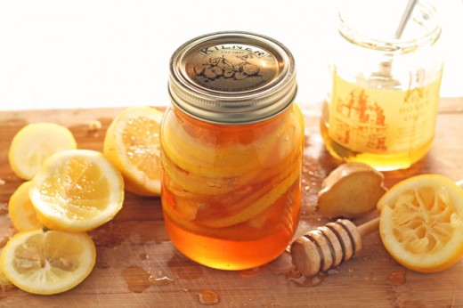 raw honey lemon and ginger in a jar. Cold remedy.